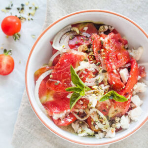 tomato salad with feta cheese and pumpkin seed oil